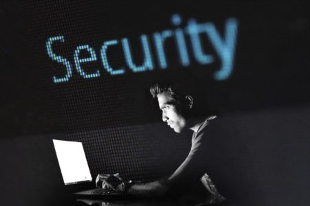 A man hacking a computer